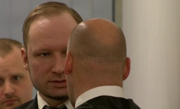 Breivik, facing, speaks with his main defense attorney Lippestad