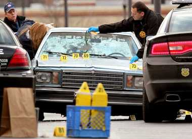 Car of unarmed suspects after chase in Cleveland.